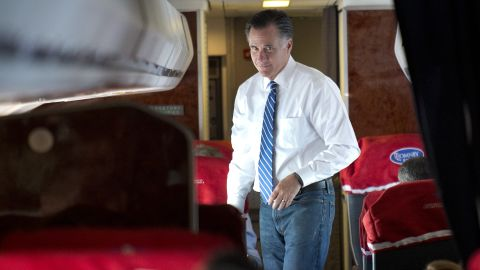 US Republican Presidential candidate Mitt Romney walks aboard his campaign plane while flying from Norfolk, Virginia, to Milwaukee, Wisconsin, on November 2, 2012.