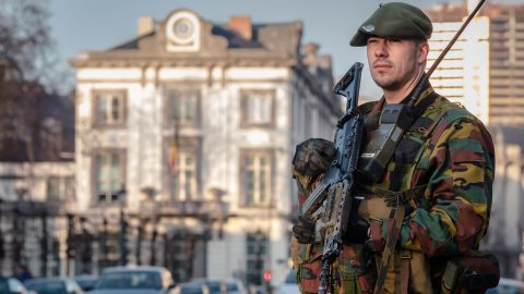 A Belgian para-commando patrols near the office of the prime minister in Brussels, on Saturday, Jan. 17, 2015. Security around Belgium has been stepped up after thirteen people were detained in Belgium in an anti-terror sweep following a firefight in Verviers, Belgium, in which two suspected terrorists were killed. (AP Photo/Geert Vanden Wijngaert)