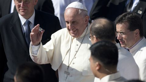 Pope Francis waves to the crowd during a departure ceremony at Villamor Airbase in Manila, Philippines, on Monday, January 19.
