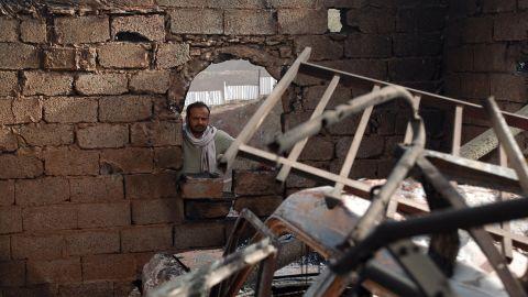 A man surveys his damaged home in Sanaa on January 20.