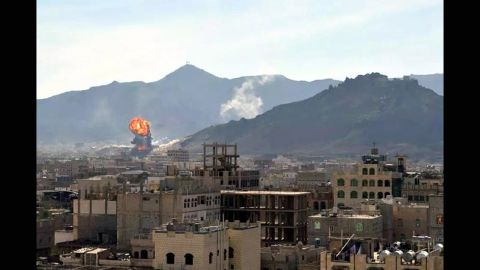 Smoke and flames rise in Sanaa during heavy clashes between presidential guards and Houthi rebels on January 19.
