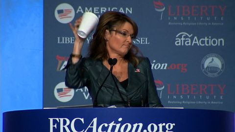 """Palin takes a jab at President Barack Obama in September, mocking his """"coffee cup salute"""" moment. Obama drew criticism after the White House posted a video to Instagram featuring him walking off Marine One offering a less-than-formal salute with a coffee cup in hand."""