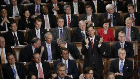 Rep. Martin Heinrich, D-New Mexico, applauds Obama while surrounded by Republican members of Congress.