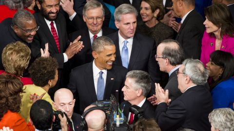Obama greets members of Congress as he arrives at the House.