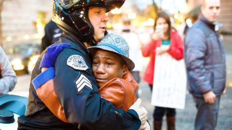 12-year-old Devonte Hart, Sgt. Bret Barnum share hug at Ferguson rally