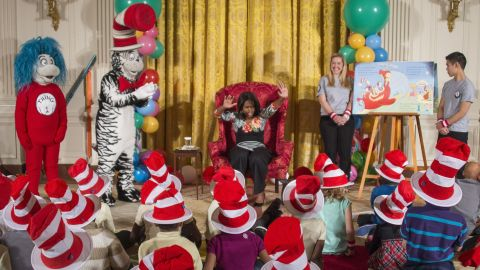 """Characters created by Geisel and """"Oh, The Places You'll Go!"""" have led to companion books and new editions. First lady Michelle Obama reads a Dr. Seuss-inspired work """"Oh, the Things You Can Do That Are Good For You"""" by Tish Rabe, to students visiting the White House in January 2015."""