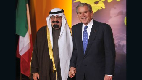 The King poses with U.S. President George W. Bush during an economic summit in Washington in November 2008.