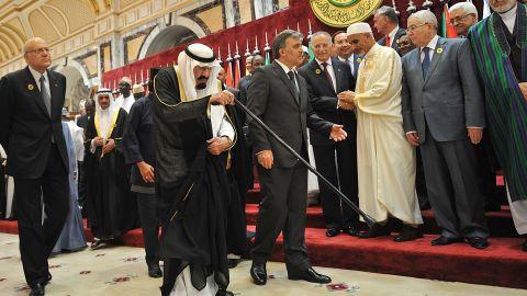 King Abdullah is escorted by Turkish President Abdullah Gul as Lebanese Prime Minister Najib Mikati, left, walks alongside them during a summit in Mecca, Saudi Arabia, in August 2012.
