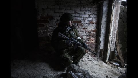 A pro-Russian rebel takes cover from shelling in the Kievsky district of Donetsk on Thursday, January 22.