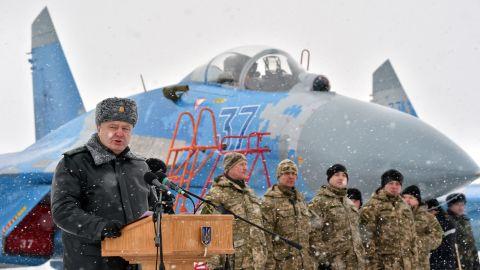 Ukrainian President Petro Poroshenko gives a speech as he hands over new military equipment to forces near the city of Ghytomyr, Ukraine, on Monday, January 5.