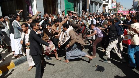 Houthi rebels fight with Yemeni protesters during a rally in Sanaa on January 24. Thousands of Yemenis took to the streets of Sanaa in the largest demonstration against Houthis since the Shiite militiamen overran the capital in September.