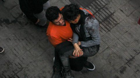 A protester carries Shaimaa El-Sabbagh, who was killed during a protest in Cairo on Saturday.