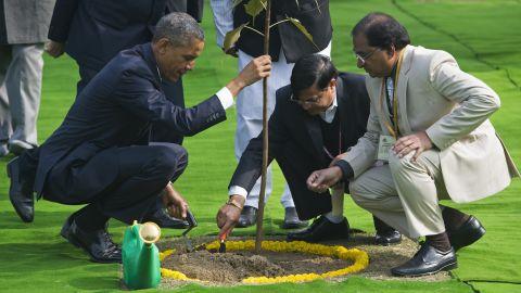 Obama participates in a tree planting ceremony at Raj Ghat, the Mahatma Gandhi Memorial.
