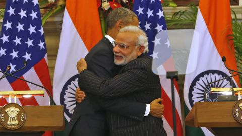 Obama and Modi hug  fter they jointly addressed the media after talks, in New Delhi.