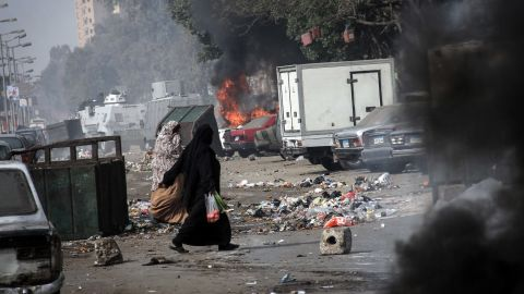 Smoke rises as a car burns in Cairo on January 25.