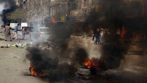 Protesters burn tires in Matariyah on January 25.