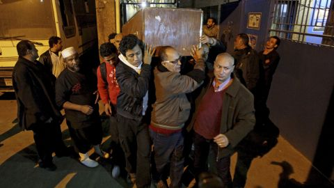 The coffin of  Shaimaa El-Sabbagh is carried out of the Zenhom morgue in Cairo early on January 25.