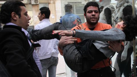 A man carries activist Shaimaa El-Sabbagh after she was shot near Tahrir Square during the protests on Saturday, January 24.   Protests marking the anniversary of the 2011 uprising that toppled Egyptian President Hosni Mubarak have turned deadly. The death of Cairo protester Shaimaa El-Sabbagh was captured on video. More than a dozen others have been killed.