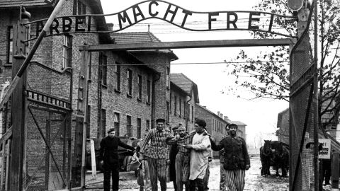 Concentration camp victims are led through the Auschwitz-Birkenau camp gate in 1945 in this photo found recently in Moscow. Auschwitz, which is known for one of the biggest Nazi concentration camps during World War II, is a site of many current controversies concerning construction of trade and entertainment centers near and on the former concentration camp grounds. Russia's Red Army liberated the camp on 27th January 1945. Above the gate is the motto 'Arbeit macht frei'  which translates to 'Work brings freedom'.