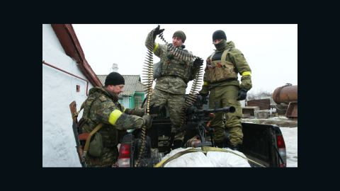 Ukrainian servicemen prepare ammunition at a position on the front line near Mariupol on January 26.