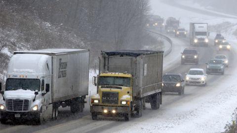 Traffic moves through the falling snow near Evans City, Pennsylvania, on January 26.
