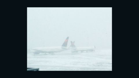Flight attendant Lia Ocampo told CNN's iReport she was getting ready for her first blizzard at JFK International Airport.