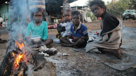 """Wik children gather around the campfire at Bull Yard outstation on Wik homelands, on the Cape York Peninsula in north Queensland. This, and the other images in this gallery, were taken by photographer Leigh Harris from <a href=""""http://ingeousstudios.com/"""" target=""""_blank"""" target=""""_blank"""">Ingeous Studios.</a>"""