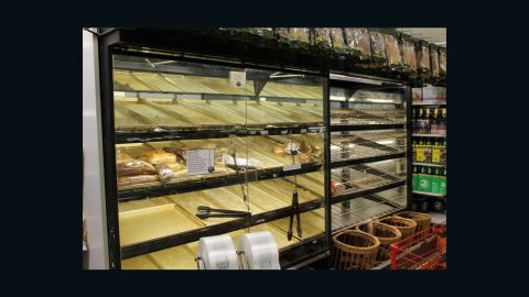 Shoppers clean out the bread shelves at a Greenwich Village grocery store