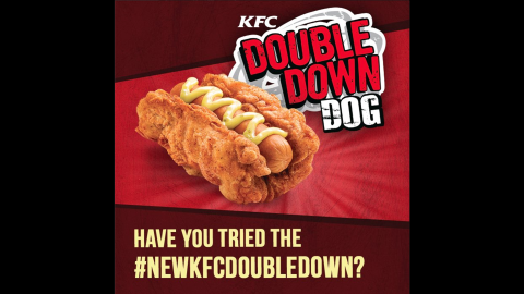 """KFC Philippines introduced the Double Down Dog at limited locations. The sandwich is composed of a cheese-filled hot dog cradled in a fried chicken fillet, topped with honey mustard and relish sauce. News of the hybrid left the Internet salivating, revolted and morbidly curious by turns. KFC, which generated hype by selling only 50 of the """"legendary"""" sandwiches at a time, said they sold out quickly."""