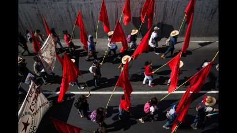People march during a protest in Mexico City, Mexico, on Monday, January 26, for the 43 students that went missing in September.
