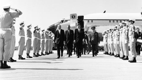 """From left, astronaut John Glenn, Vice President Lyndon B. Johnson, and President John F. Kennedy arrive at Cape Canaveral Air Force Station in February 1962. Kennedy was the first president to use a customized Boeing VC-137C as Air Force One. The plane was a military version of the Boeing 707. Code-named """"SAM 26000,"""" this jet served presidents for more than three decades."""