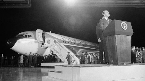 With Air Force One in the background, President Richard Nixon delivers a speech at Andrews Air Force Base near Washington after returning from his historic trip to China in February 1972.