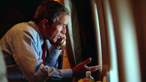 President George W. Bush, aboard Air Force One, speaks with Vice President Dick Cheney by phone on September 11, 2001.