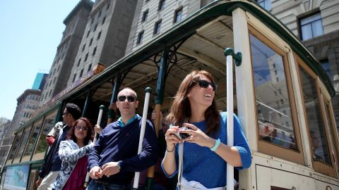 SAN FRANCISCO, CA - JUNE 09: Passengers ride a cable car as it travels along Powell Street on June 9, 2011 in San Francisco, California. Beginning on July 1, the price for a ride on San Francisco's famed cable cars will increase one dollar to $6.00. An estimated 8 million people ride the cable cars each year. (Photo by Justin Sullivan/Getty Images)