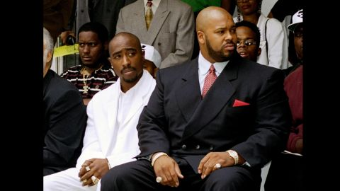 Knight and Shakur, left, attend a voter registration event in Los Angeles in August 1996. Knight was driving the car in which Shakur was a passenger when the rapper was shot to death in Las Vegas.