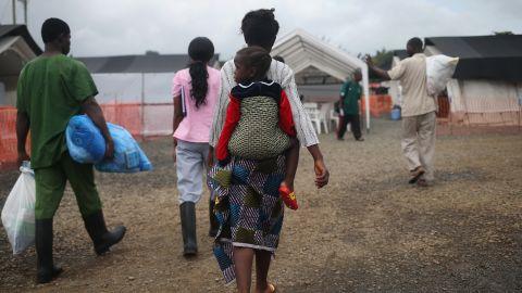 Ebola survivors leave a treatment center in Paynesville, Liberia, on October 12, 2014.