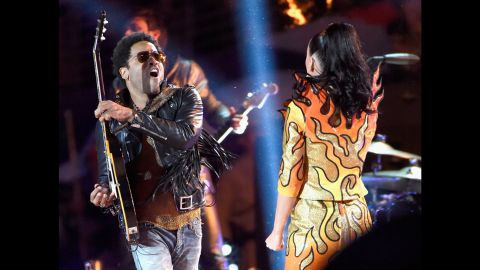 """Lenny Kravitz plays the guitar on stage with Perry as she sings """"I Kissed a Girl."""""""