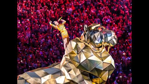 """Perry started the show by singing """"Roar"""" and riding in on a massive mechanical tiger. Or was it a lion?"""