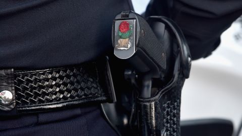 PASADENA, CA - JANUARY 01: A city of Pasadena police officer (gun detail) participates in the 126th Annual Tournament of Roses Parade presented by Honda on January 1, 2015 in Pasadena, California. (Photo by Alberto E. Rodriguez/Getty Images)