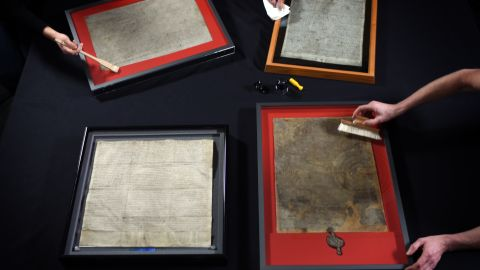 The four surviving Magna Carta manuscripts have gone on display at the British Library in London. More than 43,000 people from around the world applied for tickets to see them together; just 1,215 will get in to the historic three-day exhibition.