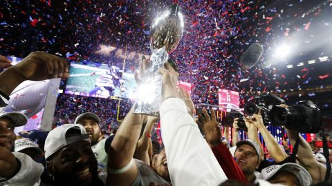 Members of the New England Patriots celebrate with the Vince Lombardi Trophy after defeating the Seattle Seahawks 28-24 in Super Bowl XLIX at University of Phoenix Stadium in Glendale, Arizona, on Sunday, February 1.