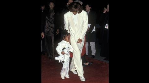 """Bobbi Kristina, 3, accompanies her mother to the premiere of """"The Preacher's Wife"""" in 1996."""