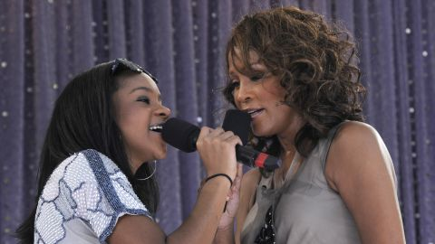 """Bobbi Kristina, 16, joins her mother for a 2009 appearance on ABC's """"Good Morning America."""" The free performance was taped in New York's Central Park."""