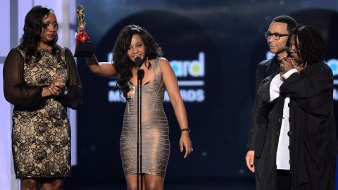 Houston's sister-in-law Pat Houston and Bobbi Kristina accept the Millennium Award on behalf of Houston at the 2012 Billboard Music Awards.