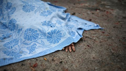 The body of a civilian killed during shelling lies on the ground in Donetsk on Friday, January 30.