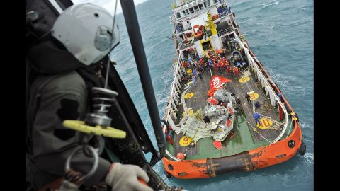 A portion of the tail section of AirAsia Flight QZ8501 appears on the deck of a rescue ship after its recovery from the Java Sea on January 10, 2015. The Airbus A320-200 lost contact with air traffic control Sunday, December 28, 2014, shortly after the pilot requested permission to turn and climb to a higher altitude because of bad weather, according to Indonesian officials.