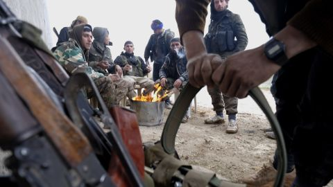 Members of the YPG prepare their ammunition on January 31.