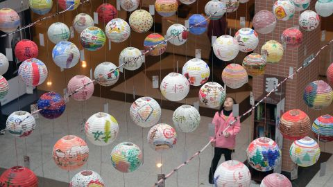 A girl admires painted lanterns during a festival in New Taipei City, Taiwan, on Saturday, January 31.