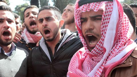 Jordanian students shout slogans during a rally to condemn the killing of Jordanian pilot Maaz al-Kassasbeh, who was killed by Islamic State (IS) group militants after he was captured by IS when his plane went down in Syria in December, at the University of Jordan in the capital Amman on February 4, 2015. Jordan executed two death-row Iraqi jihadists, including a woman, on February 4 after vowing to avenge the burning alive of its fighter pilot Maaz al-Kassasbeh. Jordan had promised to begin executing Islamic extremists on death row in response to the murder of the pilot. AFP PHOTO / STRSTR/AFP/Getty Images