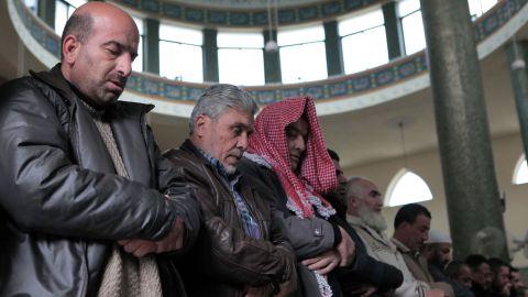 People in Amman pray for al-Kasasbeh on Wednesday, February 4.